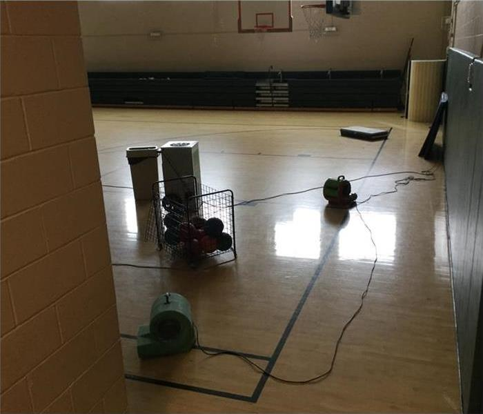 Drying equipment placed on basketball court